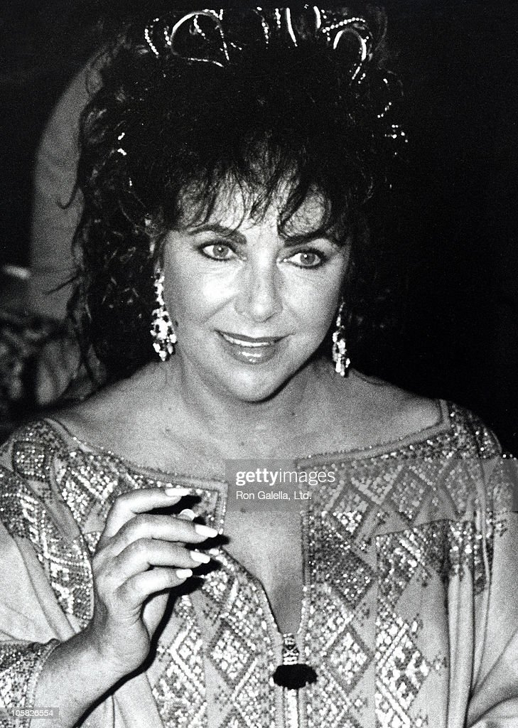 <a gi-track='captionPersonalityLinkClicked' href=/galleries/search?phrase=Elizabeth+Taylor&family=editorial&specificpeople=69995 ng-click='$event.stopPropagation()'>Elizabeth Taylor</a> during Malcolm Forbes' 70th Birthday Party, 1989 at Tangier Country Club in Tangier, Morocco.