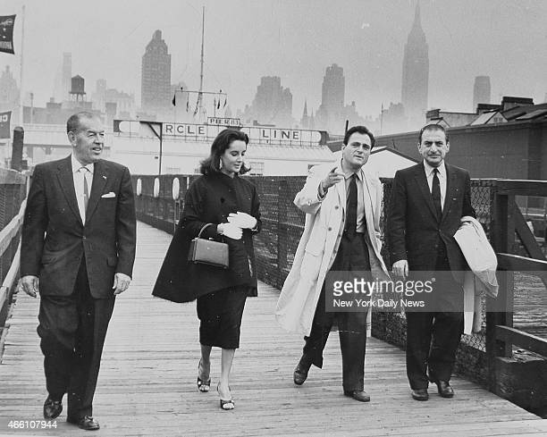 Elizabeth Taylor Mike Todd and Art Cohen as they stroll up gangway at Circle Line Pier 42 and North River Man on left is unidentified