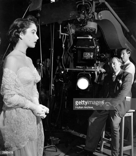 Elizabeth Taylor on the set of the film 'Conspirator' with Victor Saville directing