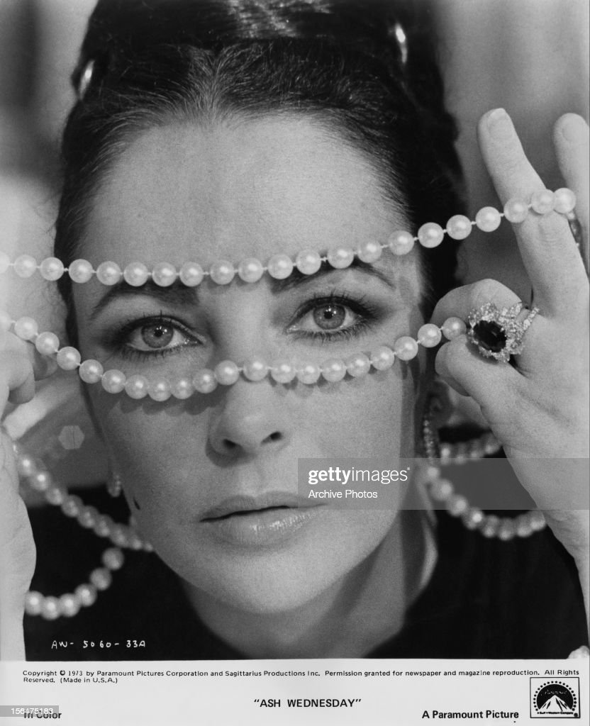 Elizabeth Taylor playing with her pearls in a scene from the film 'Ash Wednesday', 1973.