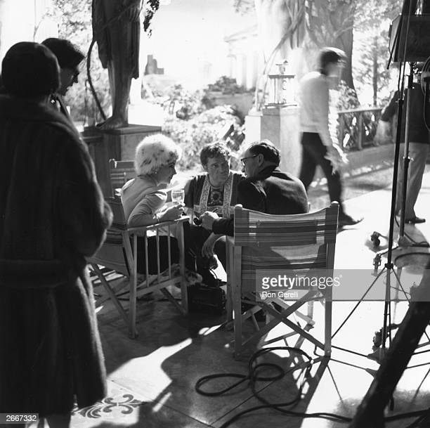 Elizabeth Taylor Richard Burton and director Joseph L Mankiewicz on the set of the film 'Cleopatra' produced by 20th Century Fox