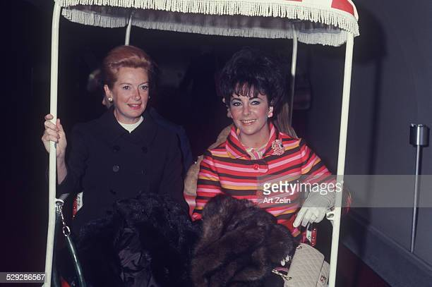 Elizabeth Taylor with Deborah Kerr in a golf cart on vacation circa 1970 New York