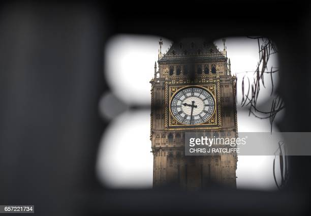 Elizabeth Tower also known by the name of the bell Big Ben is seen through the gates at the entrance to the Houses of Parliament which remain closed...