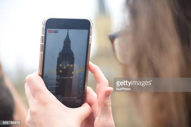 Elizabeth Tower commonly known as Big Ben is seen through a smartphone screen in the day of it 'bongs' for the final time for four years in London on...