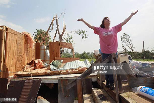 Elizabeth Vandenberg stretches her arms out as she jokingly tells her friends that her living room view now has 'wide open spaces' as she salvages...