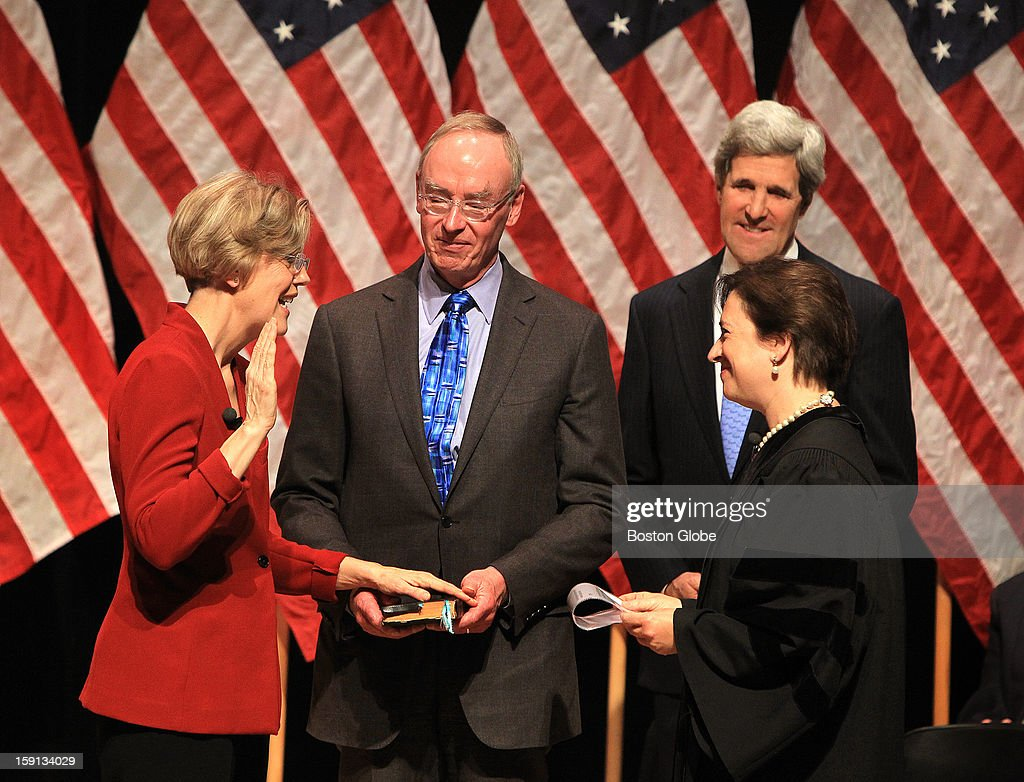 Elizabeth Warren is sworn in as Massachusetts' first woman Senator by Supreme Court Justice Elena Kagan during a re-enactment ceremony at Roxbury Community College. Warren, who was formally sworn in on Thursday in Washington, held the mock swearing-in as a way to thank supporters who couldn't travel to Washington for the actual ceremony.