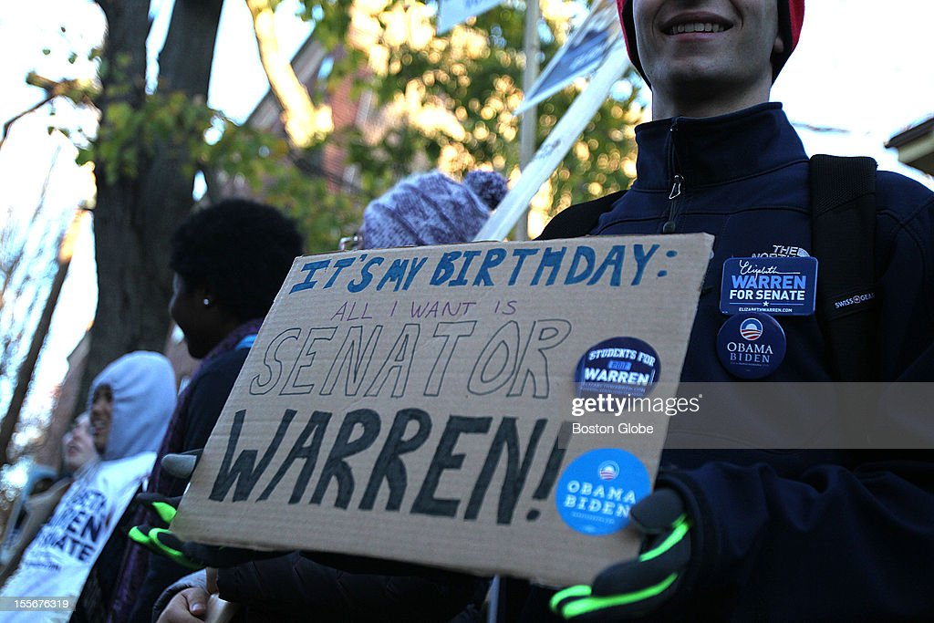Elizabeth Warren supporter Jacob Carrel holds a sign that says, 'It's my birthday: All I want is Senator Warren!' near the Graham and Parks School, a polling place in Cambridge, Mass., on Election Day.