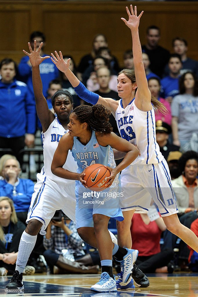 Elizabeth Williams #1 and Allison Vernerey #43 of the Duke Blue Devils pressure Xylina McDaniel #34 of the North Carolina Tar Heels at Cameron Indoor Stadium on March 3, 2013 in Durham, North Carolina.