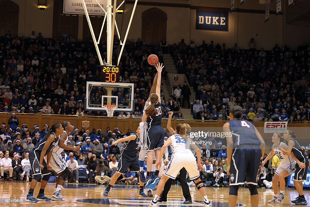 Elizabeth Williams #1 of the Duke Blue Devils and <a gi-track='captionPersonalityLinkClicked' href=/galleries/search?phrase=Breanna+Stewart&family=editorial&specificpeople=8564806 ng-click='$event.stopPropagation()'>Breanna Stewart</a> #30 of the Connecticut Huskies jump for the opening tip at Cameron Indoor Stadium on December 17, 2013 in Durham, North Carolina.