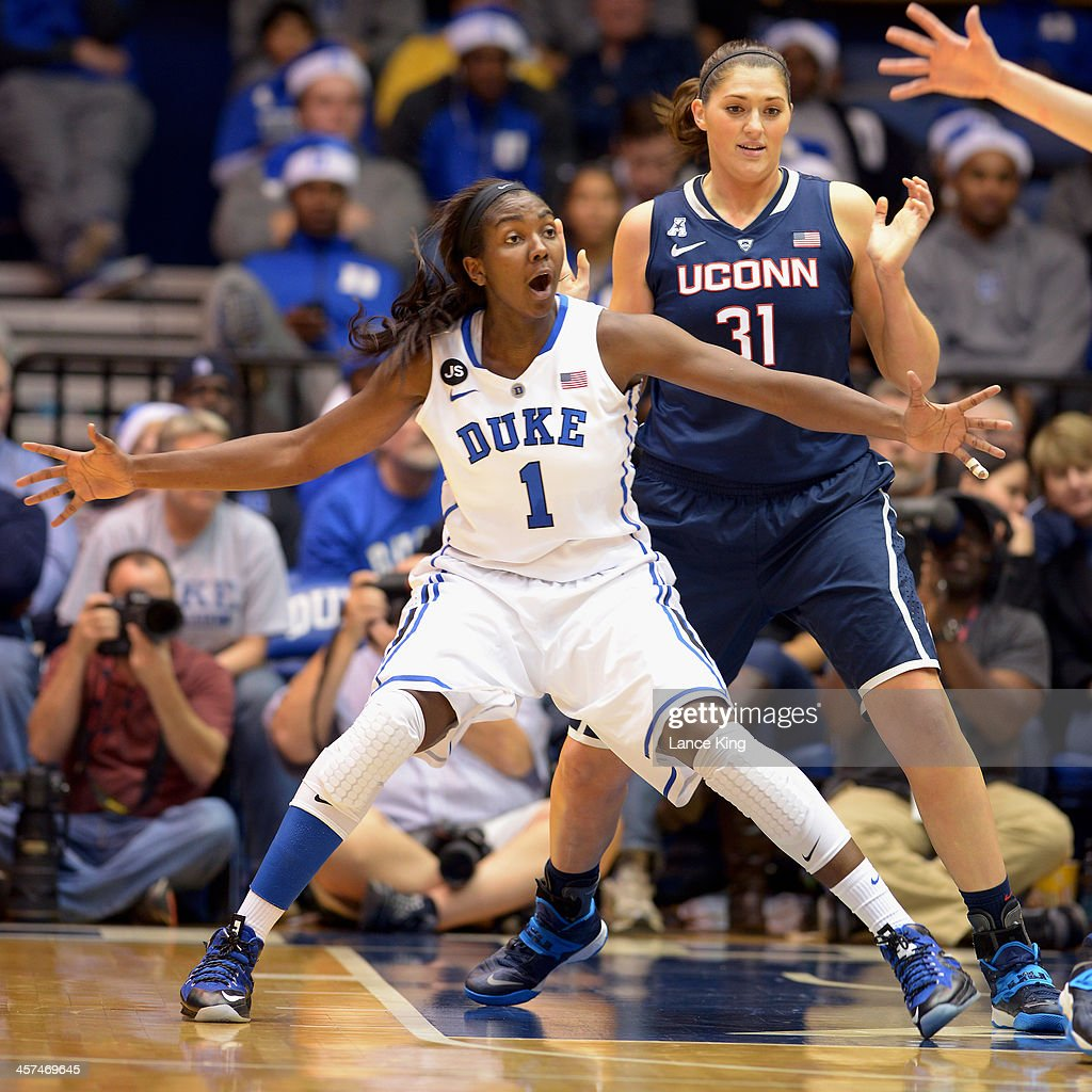 Elizabeth Williams #1 of the Duke Blue Devils calls for the ball against Stefanie Dolson #31 of the Connecticut Huskies at Cameron Indoor Stadium on December 17, 2013 in Durham, North Carolina. Connecticut defeated Duke 83-61.