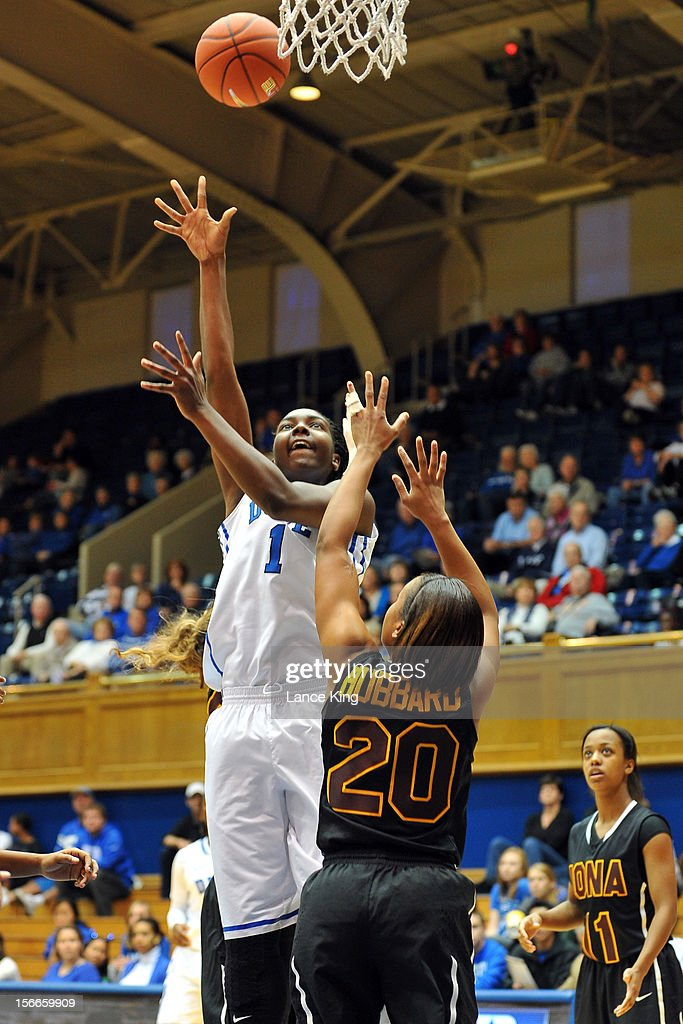 Elizabeth Williams #1 of the Duke Blue Devils puts up a shot against Diana Hubbard #20 of the Iona Gaels at Cameron Indoor Stadium on November 18, 2012 in Durham, North Carolina.