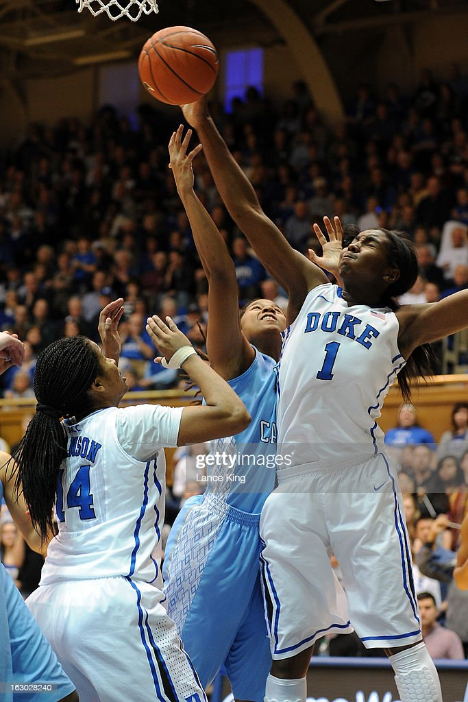 Elizabeth Williams #1 of the Duke Blue Devils reaches for a defensive rebound against Tierra Ruffin-Pratt #44 of the North Carolina Tar Heels at Cameron Indoor Stadium on March 3, 2013 in Durham, North Carolina. Duke defeated North Carolina 65-58.