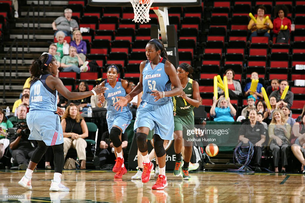 Elizabeth Williams shakes hands with Matee Ajavon of the Atlanta Dream during the game against the Seattle Storm on June 28 2016 at Key Arena in...