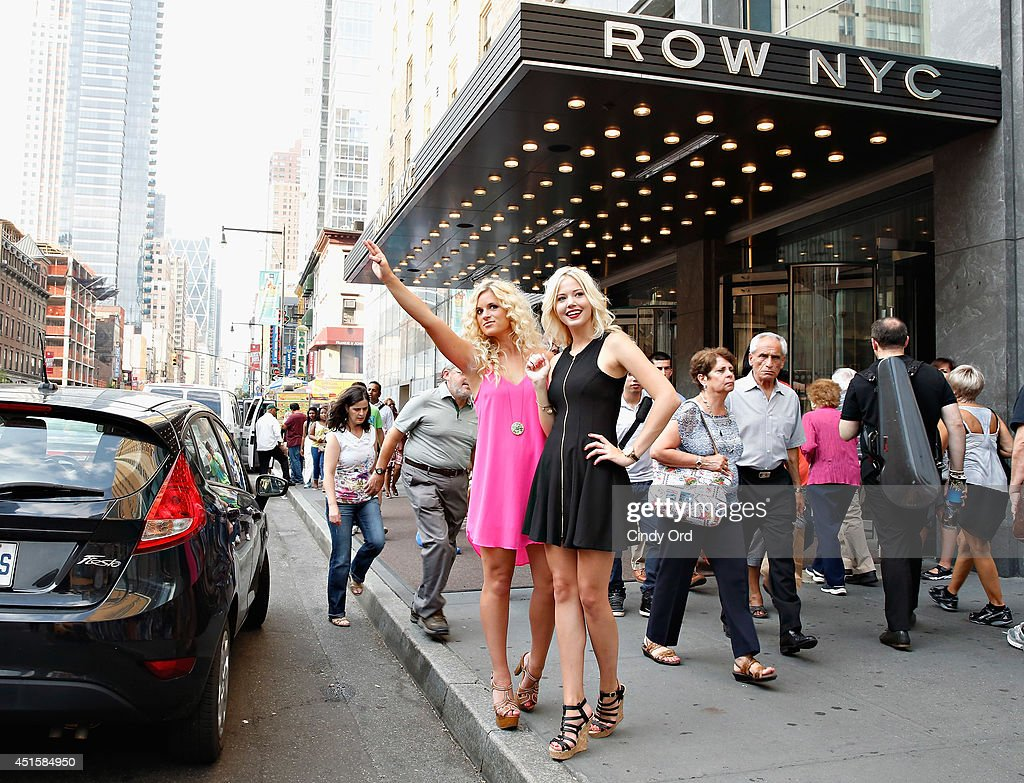 Elizabeth Wilson and Christina Boesler take part in Row NYC's 'The Paparazzi Project' at Row NYC on July 1, 2014 in New York City.