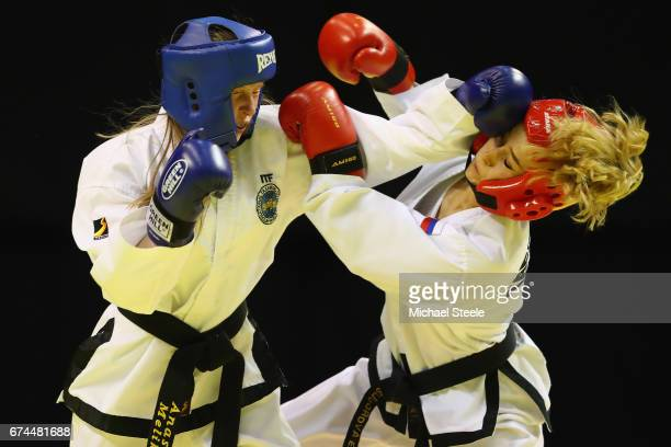 Elizaveta Suvorova of Russia competes with Anna Yumyna of Ukraine in the Individual Sparring Junior 1415 Female 46kg category during day two of the...