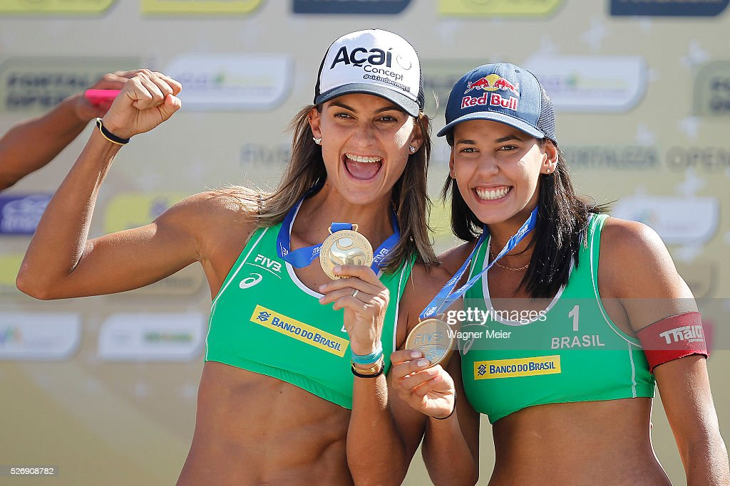 Elize Maia and Eduarda Lisboa of Brazil, receive Gold Medal during the Women Awarding ceremony during the FIVB Fortaleza Open on Futuro Beach on May 01, 2016 in Fortaleza, Brazil.