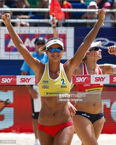 Elize Maia of Brazil celebrates their victory after winning the golden medal match against Netherlands at Pajucara beach during day six of the FIVB...