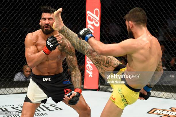 Elizeu Zaleski dos Santos of Brazil front kicks Lyman Good in their welterweight bout during the UFC Fight Night event inside the Nassau Veterans...