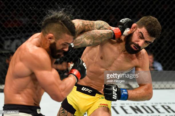 Elizeu Zaleski dos Santos of Brazil punches Lyman Good in their welterweight bout during the UFC Fight Night event inside the Nassau Veterans...