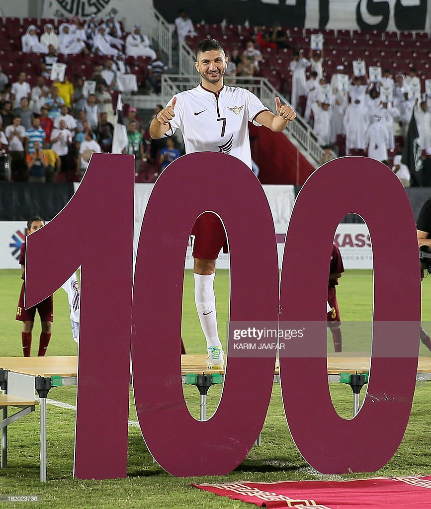 Eljaish Qatari player Wessam Rizk poses during celebrations prior to their match against Al-Sadd's in the Qatar Stars League football match in Doha on September 27, 2013, Wessam has played 100 International matchs with Qatar National team .Eljaish won 1-0.