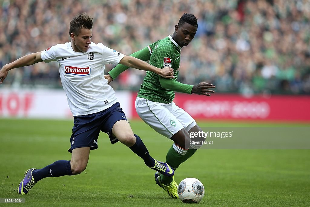 <a gi-track='captionPersonalityLinkClicked' href=/galleries/search?phrase=Eljero+Elia&family=editorial&specificpeople=2199495 ng-click='$event.stopPropagation()'>Eljero Elia</a> (R) of Bremen and Felix Klaus (R) of Freiburg compete for the ball during the First Bundesliga match between SV Werder Bremen and SC Freiburg at Weserstadion on October 19, 2013 in Bremen, Germany.