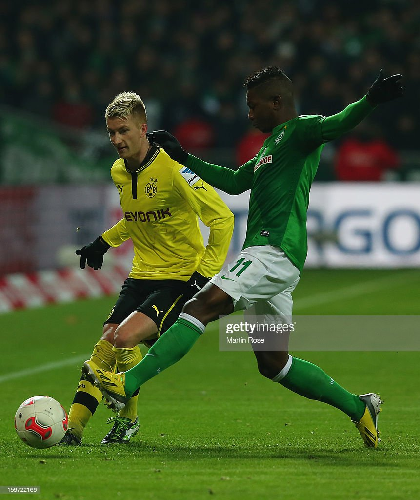 <a gi-track='captionPersonalityLinkClicked' href=/galleries/search?phrase=Eljero+Elia&family=editorial&specificpeople=2199495 ng-click='$event.stopPropagation()'>Eljero Elia</a> (R) of Bremen and <a gi-track='captionPersonalityLinkClicked' href=/galleries/search?phrase=Marco+Reus&family=editorial&specificpeople=5445884 ng-click='$event.stopPropagation()'>Marco Reus</a> (L) of Dortmund battle for the ball during the Bundesliga match between Werder Bremen and Borussia Dortmund at Weser Stadium on January 19, 2013 in Bremen, Germany.