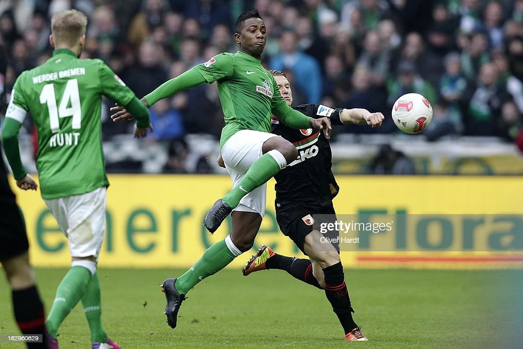 Eljero Elia (L) of Bremen and Matthias Ostrzolek (R) of Augsburg battle for the ball during the Bundesliga match between SV Werder Bremen and FC Augsburg at Weser Stadium on March 2, 2013 in Bremen, Germany.