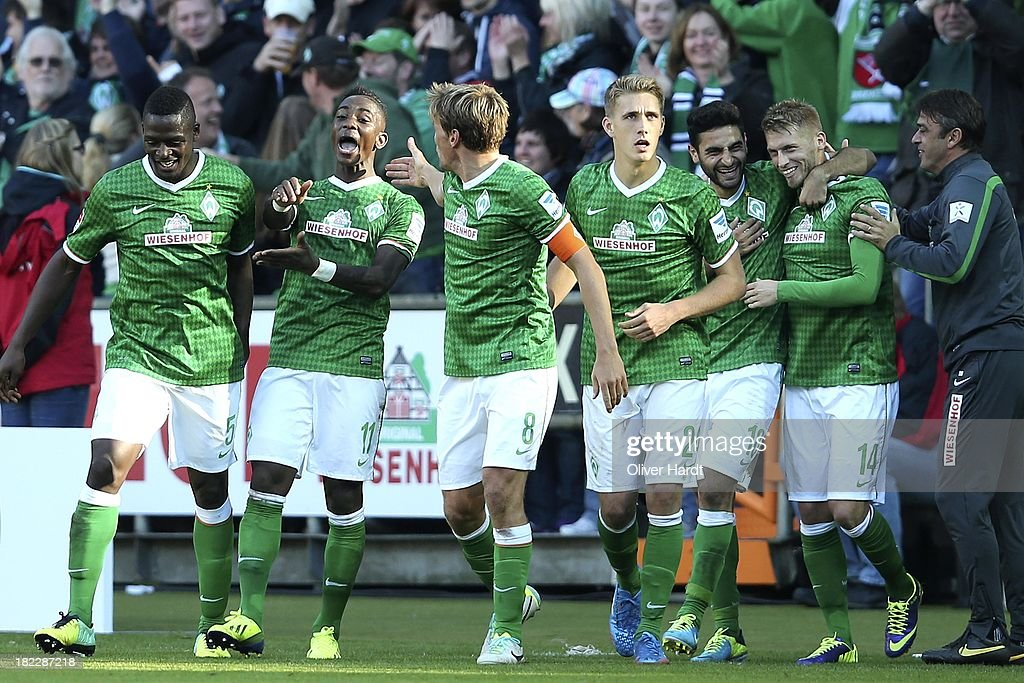 <a gi-track='captionPersonalityLinkClicked' href=/galleries/search?phrase=Eljero+Elia&family=editorial&specificpeople=2199495 ng-click='$event.stopPropagation()'>Eljero Elia</a> (2.L) of Bremen celebrates after scoring their second goal during the First Bundesliga match between SV Werder Bremen and 1.FC Nuernberg at Weserstadion on September 29, 2013 in Bremen, Germany.