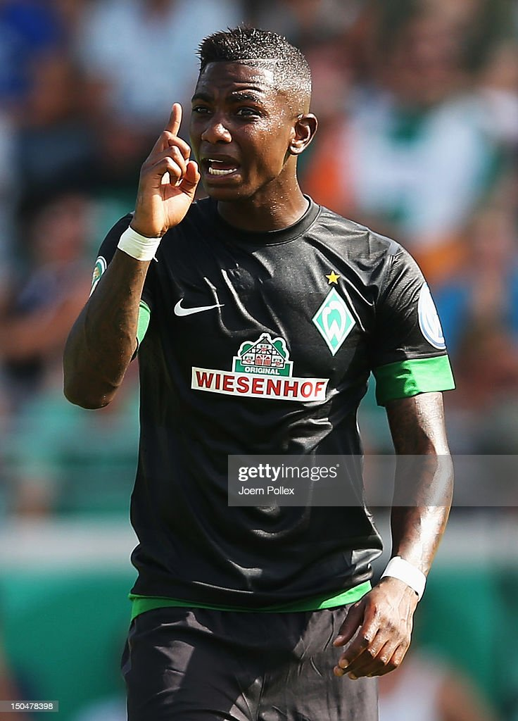 <a gi-track='captionPersonalityLinkClicked' href=/galleries/search?phrase=Eljero+Elia&family=editorial&specificpeople=2199495 ng-click='$event.stopPropagation()'>Eljero Elia</a> of Bremen gestures during the DFB Cup first round match between Preussen Muenster and Werder Bremen at Preussenstadion on August 19, 2012 in Muenster, Germany.
