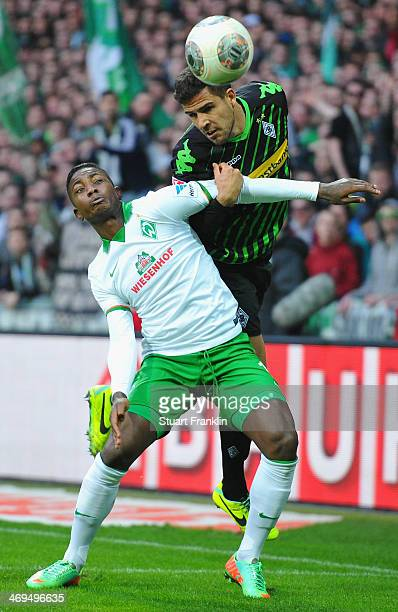 Eljero Elia of Bremen is challenged by Alvaro Dominguez Soto of Gladbach during the Bundesliga match between Werder Bremen and Borussia...