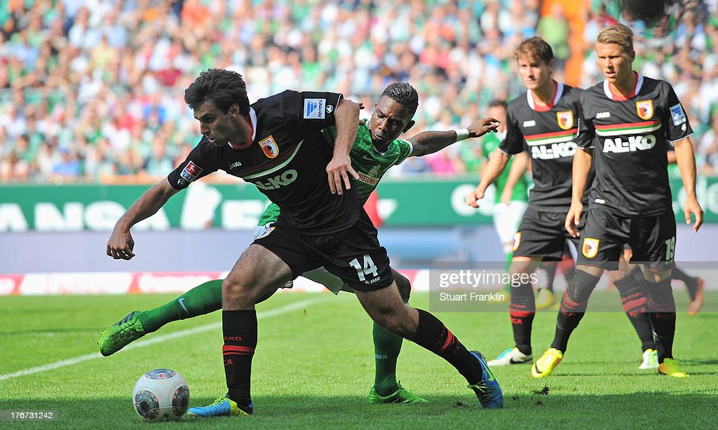 <a gi-track='captionPersonalityLinkClicked' href=/galleries/search?phrase=Eljero+Elia&family=editorial&specificpeople=2199495 ng-click='$event.stopPropagation()'>Eljero Elia</a> of Bremen is challenged by <a gi-track='captionPersonalityLinkClicked' href=/galleries/search?phrase=Jan+Moravek&family=editorial&specificpeople=5437866 ng-click='$event.stopPropagation()'>Jan Moravek</a> of Augsburg during the Bundesliga match between Werder Bremen and FC Augsburg at Weserstadion on August 17, 2013 in Bremen, Germany.