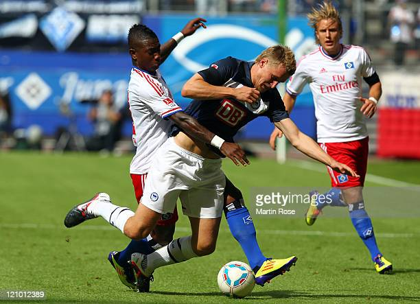 Eljero Elia of Hamburg and Christian Lell of Berlin battle for the ball during the Bundesliga match between Hamburger SV and Hertha BSC Berlin at...