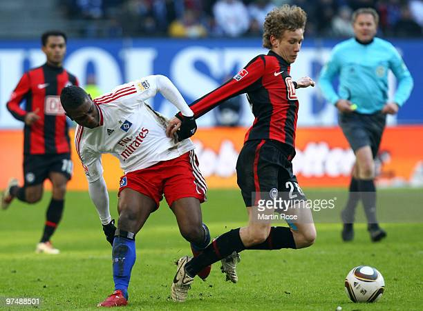 Eljero Elia of Hamburg and Fabian Lustenberger of Berlin compete for the ball during the Bundesliga match between Hamburger SV and Hertha BSC Berlin...