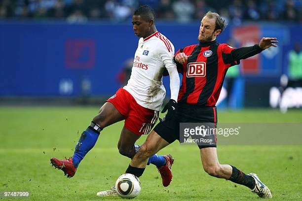 Eljero Elia of Hamburg and Roman Hubnik of Berlin compete for the ball during the Bundesliga match between Hamburger SV and Hertha BSC Berlin at HSH...
