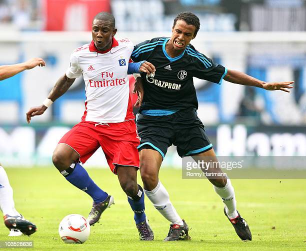 Eljero Elia of Hamburg battles for the ball with Joel Matip of Schalke 04 during the Bundesliga match between Hamburger SV and FC Schalke 04 at...