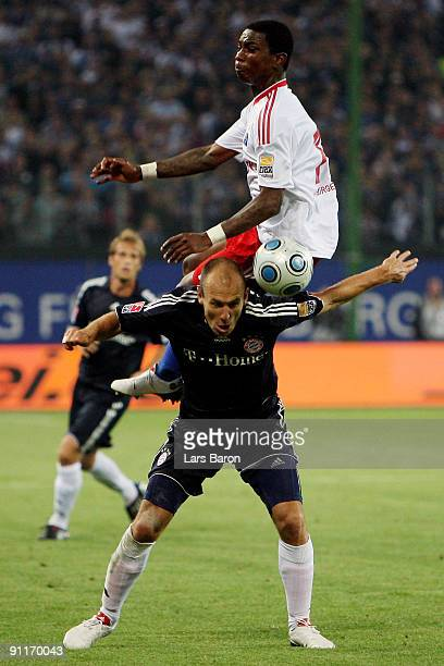 Eljero Elia of Hamburg jumps over Arjen Robben of Muenchen during the Bundesliga match between Hamburger SV and FC Bayern Muenchen at HSH Nordbank...