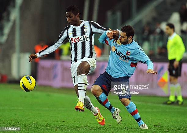 Eljero Elia of Juventus FC competes with Archimede Morleo of Bologna FC during the Tim Cup match between Juventus FC and Bologna FC at Juventus Arena...