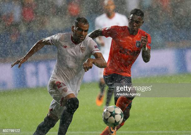 Eljero Elia of Medipol Basaksehir in action against Gabriel Mercado of Sevilla FC during the UEFA Champions League playoff match between Medipol...