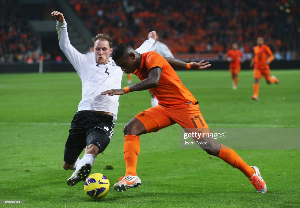 Eljero Elia (R) of Netherlands and Benedikt Hoewedes of Germany compete for the ball during the International Friendly match between Netherlands and Germany at Amsterdam Arena on November 14, 2012 in Amsterdam, Netherlands.
