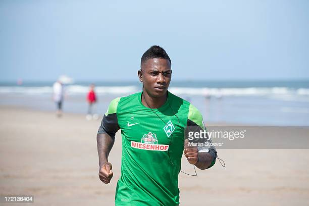Eljero Elia runs on the beach during a training session on July 2 2013 in Norderney Germany