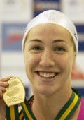 Elka Graham shows off her gold medal after winning the Womens 100 metres Freestyle Final at the Australian Short Course Championships at the...