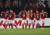 Elkeson de Oliveira Cardoso of Guangzhou Evergrande is congratulated by his team mates after scoring a goal during the AFC Asian Champions League...