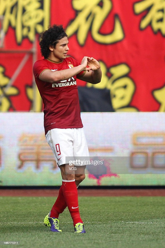 <a gi-track='captionPersonalityLinkClicked' href=/galleries/search?phrase=Elkeson+-+Soccer+Player&family=editorial&specificpeople=6343595 ng-click='$event.stopPropagation()'>Elkeson</a> #9 of Guangzhou Evergrande celebrates after scoring his team's first goal during the Chinese Super League match between Guangzhou Evergrande and Wuhan Zall at Tianhe Sports Center on November 3, 2013 in Guangzhou, China.