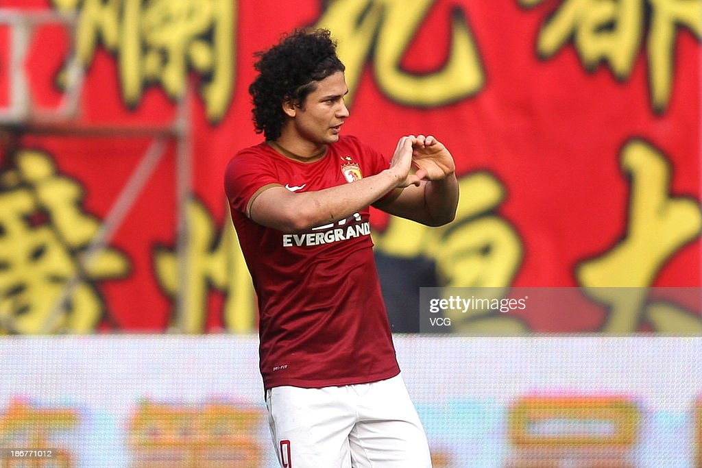 Elkeson #9 of Guangzhou Evergrande celebrates after scoring his team's first goal during the Chinese Super League match between Guangzhou Evergrande and Wuhan Zall at Tianhe Sports Center on November 3, 2013 in Guangzhou, China.