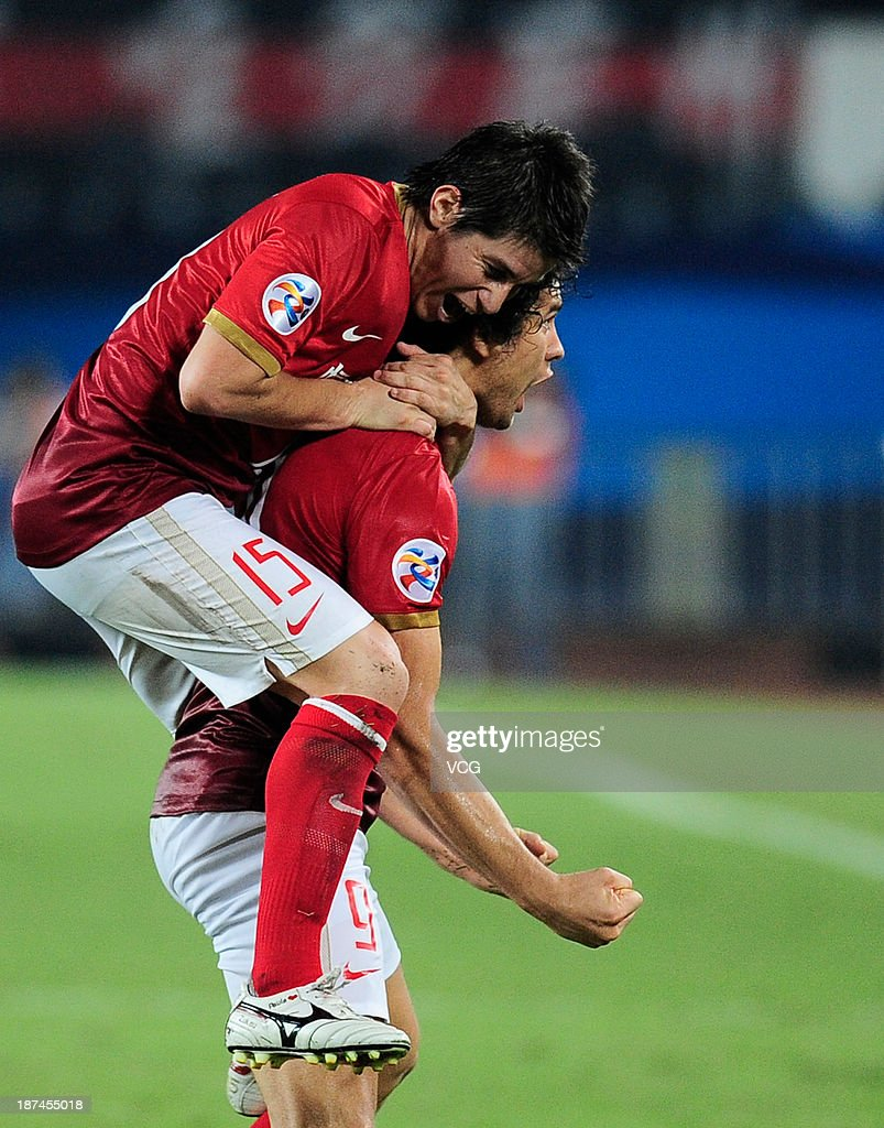 Elkeson of Guangzhou Evergrande celebrates with team mate Dario Conca after scoring his team's first goal during the AFC Champions League Final 2nd...