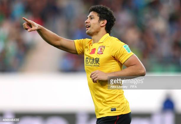 Elkeson of Guangzhou Evergrande FC celebrates after scoring the opening goal during the FIFA Club World Cup Quarter Final match between Guangzhou...