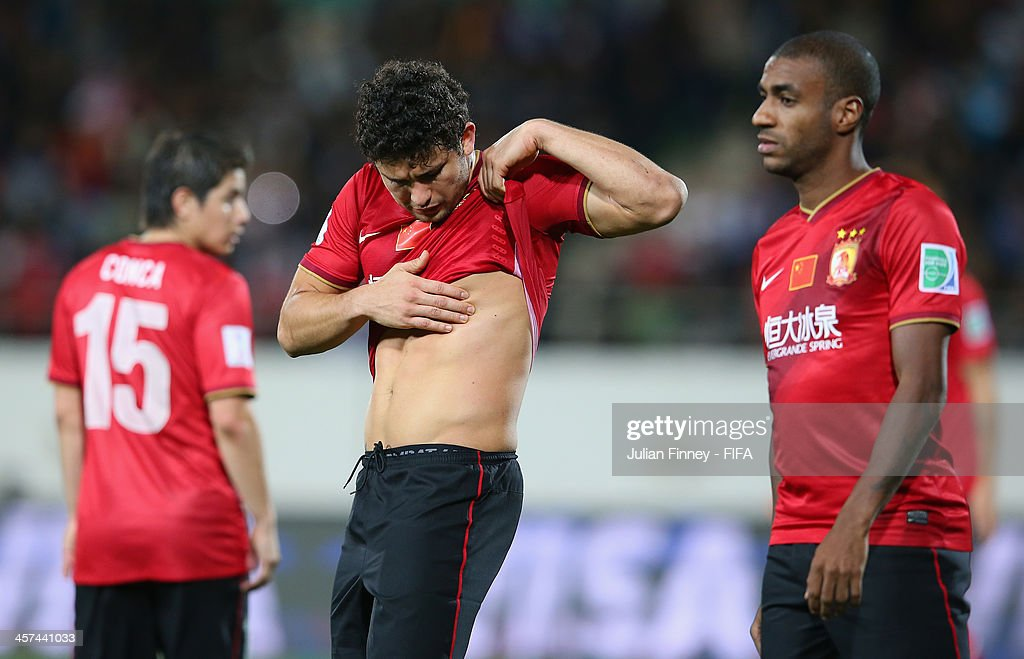 Elkeson of Guangzhou Evergrande FC checks his body after a tackle during the FIFA Club World Cup Semi Final match between Guangzhou Evergrande FC and Bayern Muenchen at the Agadir Stadium on December 17, 2013 in Agadir, Morocco.