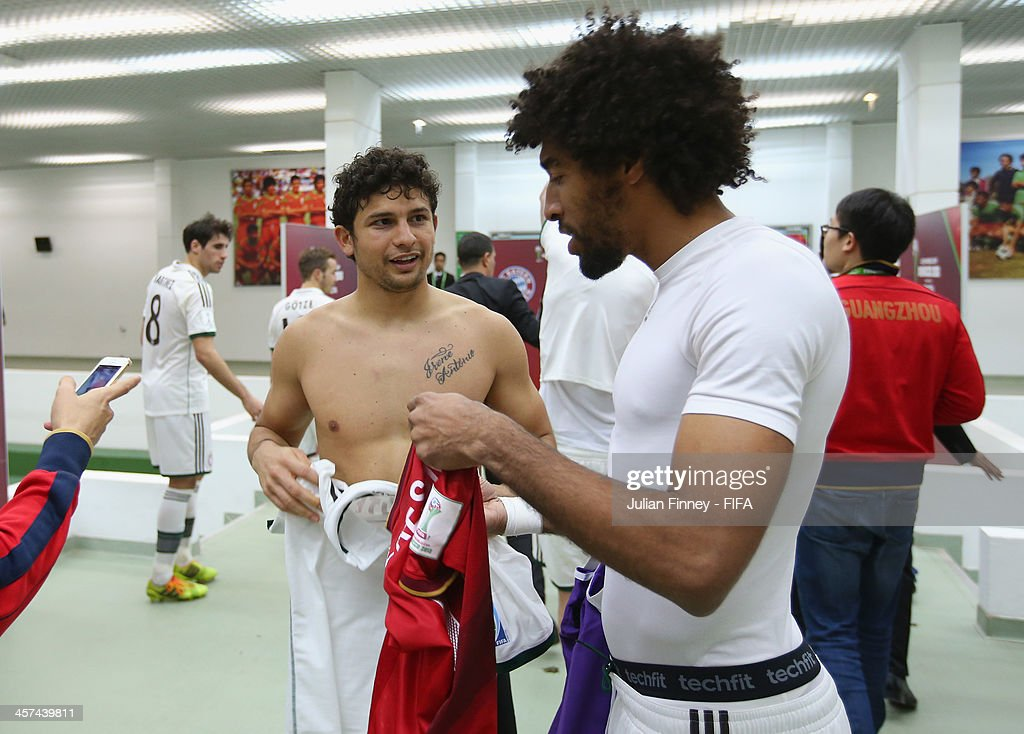 Elkeson of Guangzhou Evergrande FC swaps shirts with Dante of Bayern Muenchen after the FIFA Club World Cup Semi Final match between Guangzhou Evergrande FC and Bayern Muenchen at the Agadir Stadium on December 17, 2013 in Agadir, Morocco.