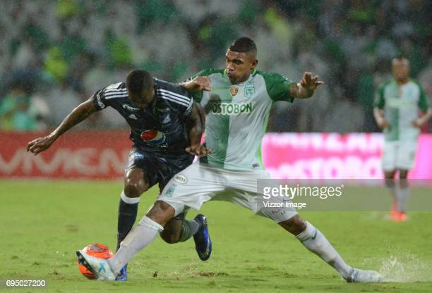 Elkin Blanco of Atletico Nacional fights for the ball with Duver Riascos of Millonarios during the semi finals second leg match between Atletico...
