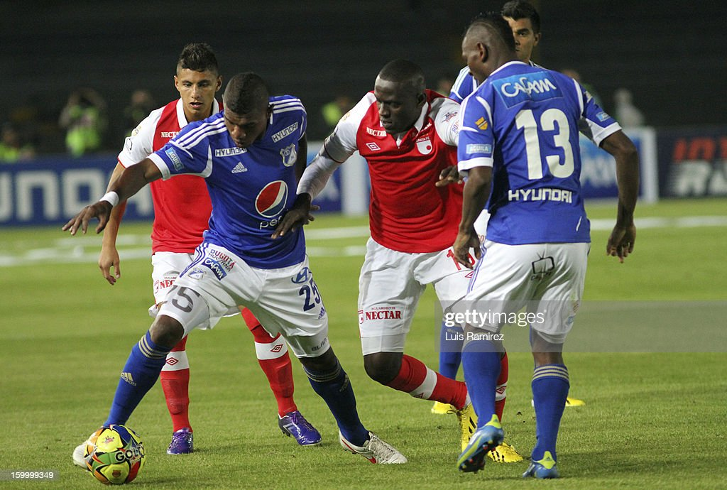 Elkin Blanco (R) of Millonarios fights for the ball with Cristian Borja (L) of Independiente Santa Fe during a match between Millonarios and Independiente Santa Fe as part of the Superliga Postobon 2013 at the Nemesio Camacho Stadium on January 24, 2013 in Bogota, Colombia.